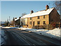 TL1183 : Snow cover at White Hart Cottage, Great Gidding by Michael Trolove