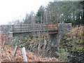 Dist:0.9km<br/>The bridge connects, via a rough footpath, the woods to the A96 trunk road just east of Pitcaple.