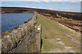 SD9839 : Footpath on the Dam, Keighley Moor Reservoir by Mark Anderson