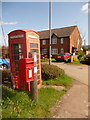 ST9764 : St. Edith�s Marsh: postbox № SN15 221 and redundant phone box by Chris Downer