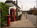 ST8211 : Shillingstone: postbox № DT11 93 and phone, The Cross by Chris Downer