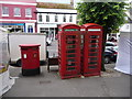 SY4692 : Bridport: postbox № DT6 2000 and phones, West Street by Chris Downer