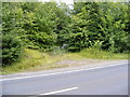 TM3764 : Former Road & entrance to Ash Ground by Adrian Cable