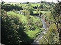 Dist:0.6km<br/>A small river, a tributary of the Irvine, running through grassland. Seen from the disused Glasgow, Paisley, Kilmarnock and Ayr Railway, now a cycle path.