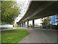TQ3776 : Cycle path under the DLR viaduct by Stephen Craven