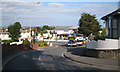 Mount Pleasant Road turns back into Warren Road, left of centre, at its junction with Beachway (under the Monterey Cypresses, right). From this point there is a glimpse across the mouth of the Exe to the coast east of Exmouth.