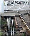 TL0997 : Point rodding at Wansford level crossing by Andy F