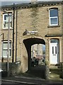 SE1422 : Archway to George Terrace, George Street, Rastrick by Humphrey Bolton