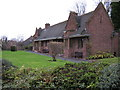 SP1093 : Glovers Trust Alms Houses, Chester Road by Michael Westley