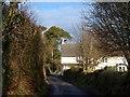 SX0562 : Lane at Trebell Green by Derek Harper