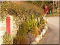 SY7387 : West Knighton: postboxes old and new by Chris Downer
