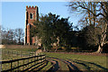 TL1965 : Approaching Diddington church by Kate Jewell