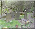 SD9026 : Grave stones in the Methodist graveyard, Cornholme, Todmorden by Humphrey Bolton