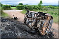 SS9310 : Mid Devon : Burnt Out Vehicle by Lewis Clarke