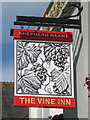 TQ8833 : The Vine Inn sign by Oast House Archive