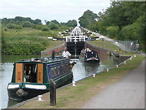 ST9761 : Two narrow boats descend the Caen Hill Locks by Russel Wills