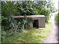 TM3877 : Pillbox on the footpath to Station Road by Adrian Cable