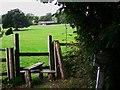 SU9416 : Stile on footpath near East Lavington by Shazz