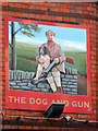 TQ7656 : The Dog and Gun sign by Oast House Archive
