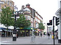 High Street, Sutton, looking south from the junction of Cheam Road.  Note the direction signs attached to the pub sign.