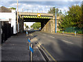 Dist:0.2km<br/>Looking along Station Road towards the railway bridge for the North Wales main line. There is a bench mark on the right hand buttress of the bridge [[2120189]]