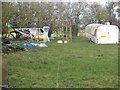 ST6058 : Microlight aircraft parked in corner of farmland by Dr Duncan Pepper