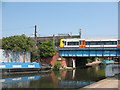 TQ2282 : Train crossing the Grand Union Canal by Stephen Craven