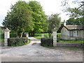 SJ8671 : Gatehouse and entrance drive Thornycroft Hall by Peter Turner