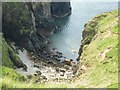 NR2847 : Tiny beach at foot of precipitous cliffs on the Oa peninsula, Islay by Becky Williamson