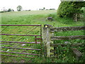 SJ3106 : Old gate, gatepost, waymarker and stile by Jeremy Bolwell