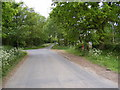 TG0523 : Reepham Road &amp; The Village Postbox by Adrian Cable