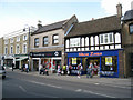 TL1860 : Shops in St Neots High Street by Sebastian Ballard