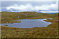 NG4540 : Lochan close to the summit of Skriaig by John Allan