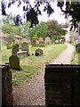 TM3055 : Footpath through the Churchyard to the B1438 High Street by Adrian Cable