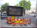 TQ2978 : Temporary road sign on junction of Vauxhall Bridge and Grosvenor Roads by PAUL FARMER