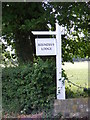 TM2870 : Brundish Lodge name sign by Adrian Cable