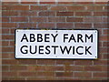 TG0527 : Abbey Farm,  name sign by Adrian Cable