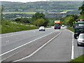 Dist:1.0km&lt;br/&gt;Looking down the hill on the A494 near Mynydd Isa.