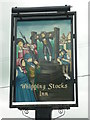 SJ7674 : The sign for the Whipping Stocks, a Sam Smith's pub by Ian S