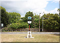 TQ5193 : Village sign on village green by John Salmon