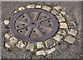 "J5081 : ""Cartwheel"" manhole cover, Bangor by Albert Bridge"