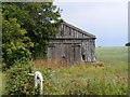 TG0623 : Barn off Kerdiston Road by Adrian Cable