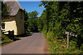 SS9345 : Tivington: cottage and bridleway by Christopher Hilton