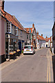TG0243 : Looking down Blakeney High Street by Peter Facey