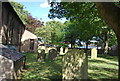 NU2229 : Churchyard of St Ebba's Church by Nigel Chadwick