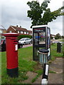SU9953 : Jacobs Well: postbox &#8470; GU4 264 and phone, Stringers Avenue by Chris Downer