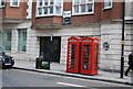TQ2880 : Two telephones, Curzon St by N Chadwick