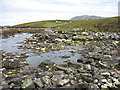 NF8962 : Stepping stones at the outlet from Loch Obasaraigh by David Purchase