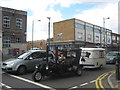 Three-wheeled custom built bike towing a caravan.