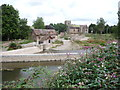 SO4876 : Bromfield church and the weir on the Teme under reconstruction by Jeremy Bolwell
